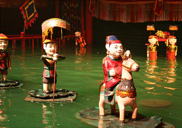 A Water Puppet Show at Thang Long Water Puppet Theatre, located on Dinh Tien Hoang St. near the Old Quarters of Hanoi. A really popular place for tourists and those who love traditional arts of Vietnam