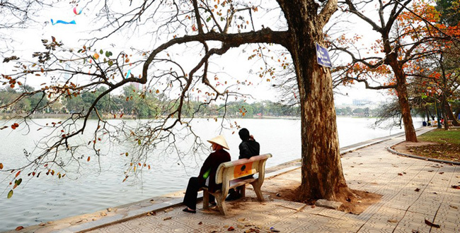 Take a leisure stroll on the sidewalks of hoan kiem lake just outside of the old quarters