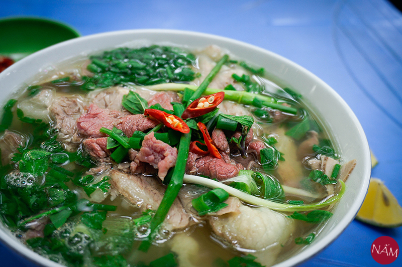 A bowl of hot pho on Ly Quoc Su St. near Old Quarters of Hanoi