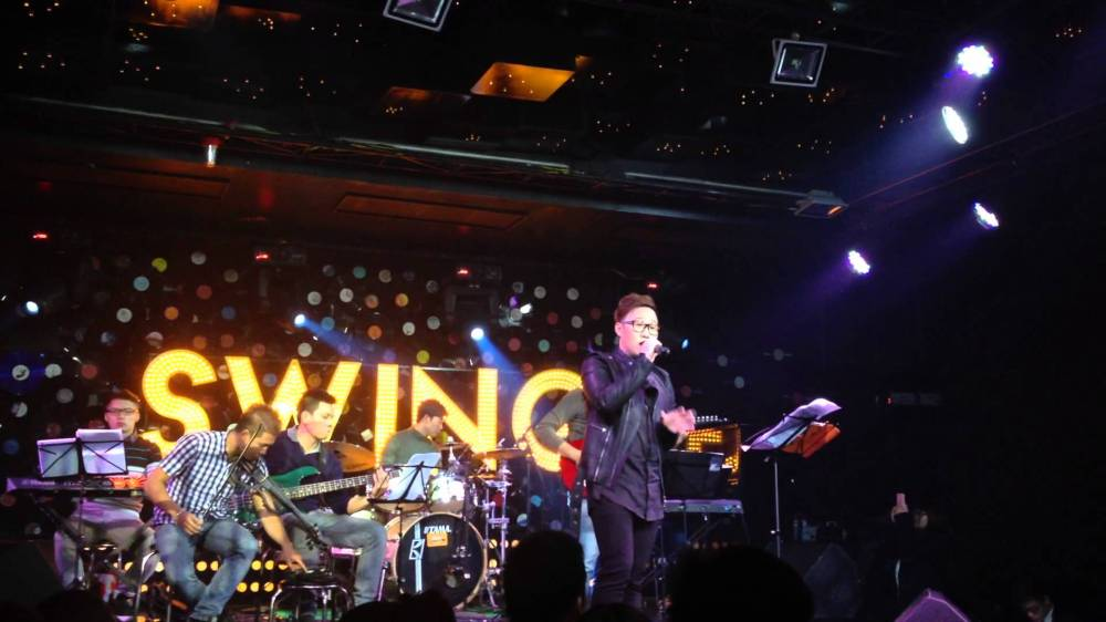 watch popular vpop singers perform at swing lounge hanoi on trang tien street. in the picture is trung quan, who achieved fame following his participation in vietnam idol season 3